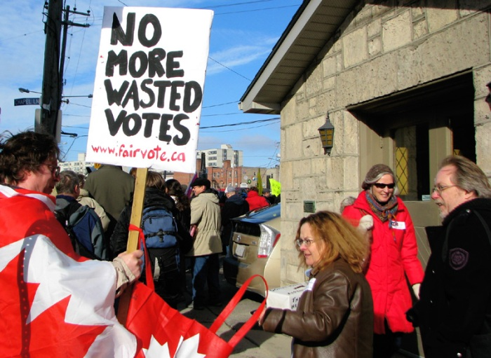 The fair vote Canada guy sports a Canadian Flag cape: No More Wasted Votes