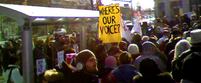 Sign in the crowd reads: Where's Our Voice?