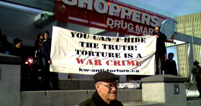 A Banner Reads: You Can't Hide The Truth - Torture is A War Crime - kw-anti-torture.ca