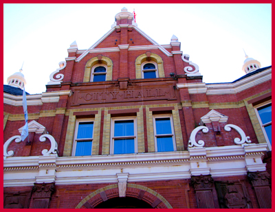 Looking up at the Stratford City Hall Facade over the front door