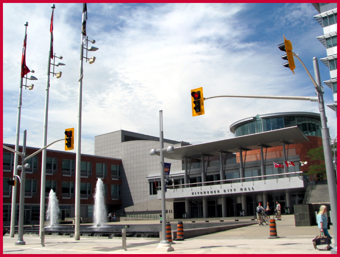 The sterile glass and steel Kitchener City Hall of today.