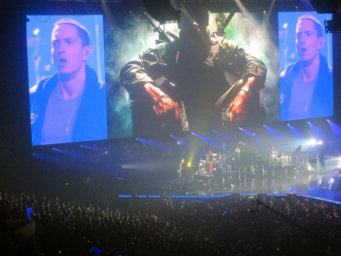 Giant screens project Eminem's image above the distant stage