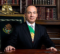 President  Felipe Calderón posed in front of a book lined backdrop
