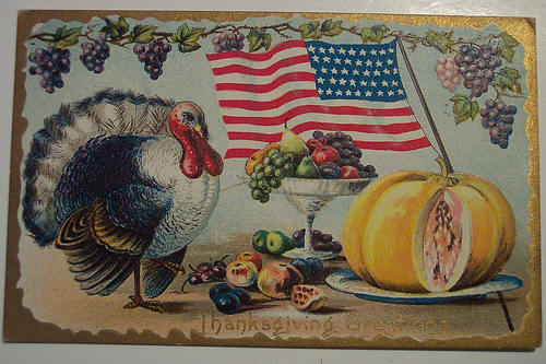 a live turkey with the stars and stripes flying overhead