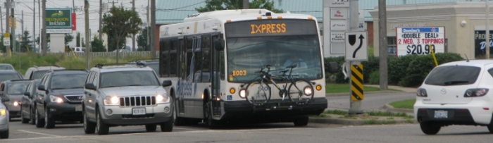 IXpress bus driving in urban area