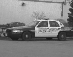 black and white police car parked in a lot