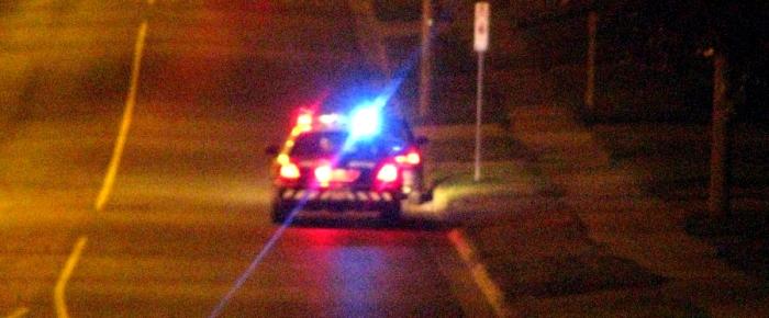 police car traffic stop at night