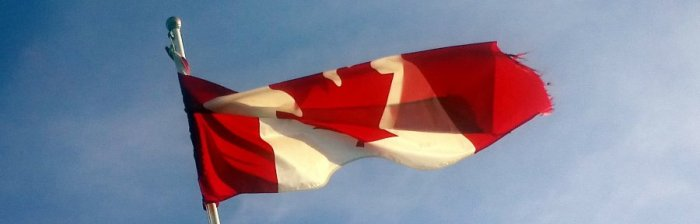 Canadian flag twisting in the wind (cc by laurelrusswurm)