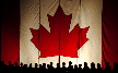 Silhouetted people in front of a large Canadian Flag