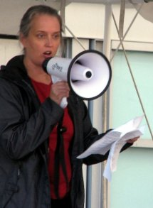 Heather Douglas, Ph.D.speaks to the crowd via megaphone