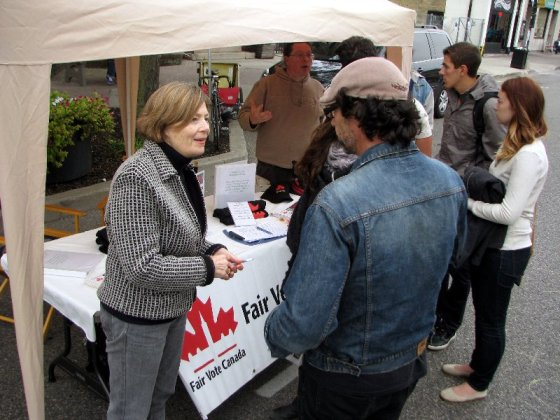 At Waterloo's OPEN STREETS, Fair Vote Canada (WRC) co-Chair Sharon Sommerville fields electoral reform questions with assistance from Bob Jonkman.
