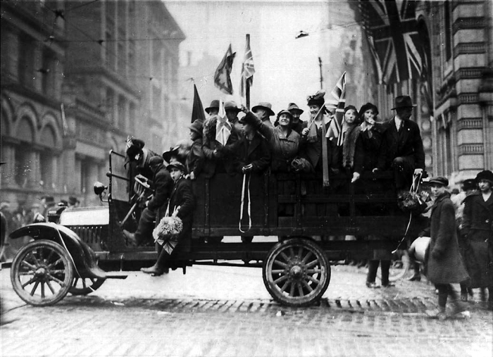 "A car load of revellers celebrates the end of the ""War to End All Wars"""