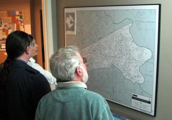 David, Bob and Sharon look at the map