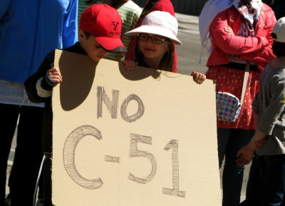 Children holding a No C-51 sign